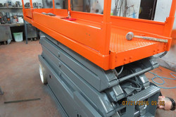 Scissor lift blasted & painted