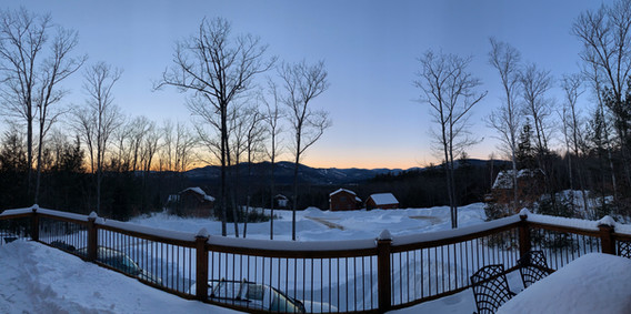 Snowy view from the front deck at dusk.