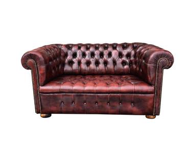 Ron Burgundy: Vintage Leather Loveseat
