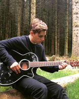 Video-of-Alex-Williams-playing-acoustic-guitar-in-Wales