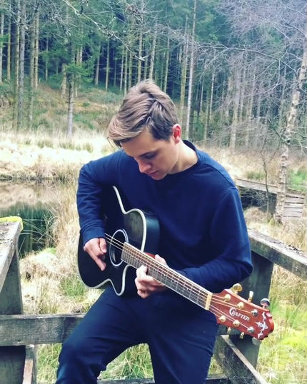 Alex-Williams-playing-country-music-on-guitar-in-Wales