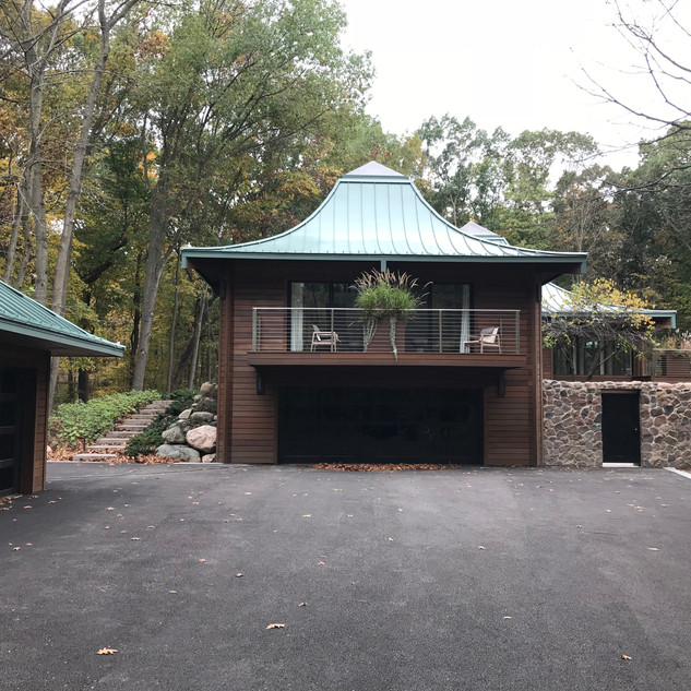 Attached garage w/ stone wall