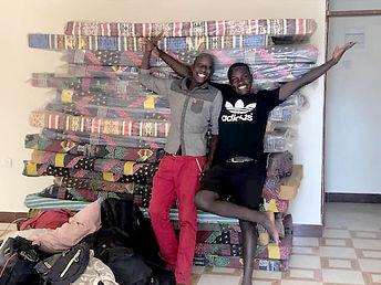 Muko and Juma with mattresses.