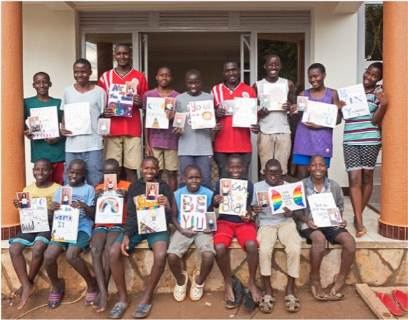 Children with artwork at new home.