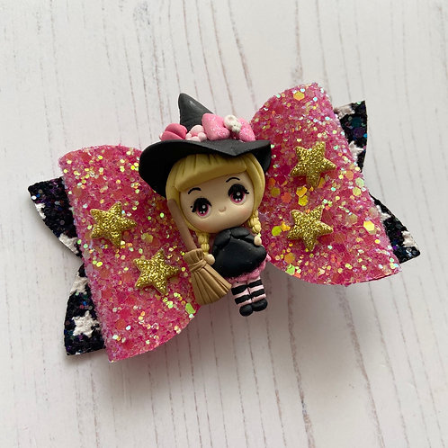 Pink star witch bow