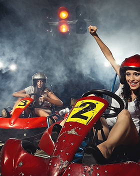 girl is driving Go-kart with speed in Ka