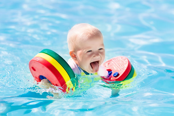 Happy laughing little baby boy playing i