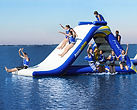 Freefall inflatable slide