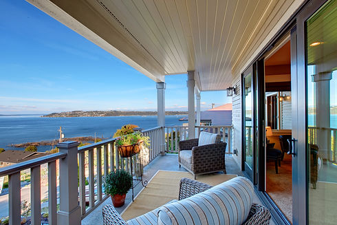 Cozy walkout deck with chairs with sceni