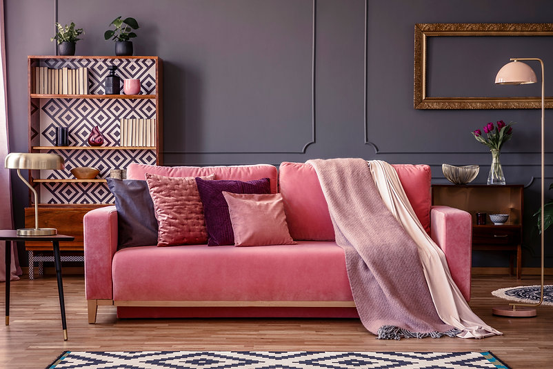 Front view of a pink sofa with pillows a