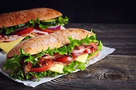 Two fresh submarine sandwiches with ham,
