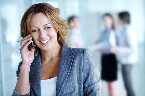 Image of pretty businesswoman calling on