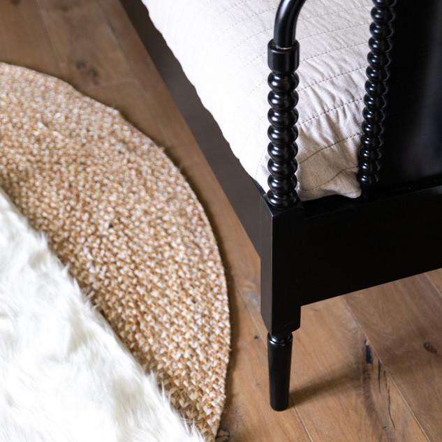 28-room-design-bed-layered-rugs.jpg