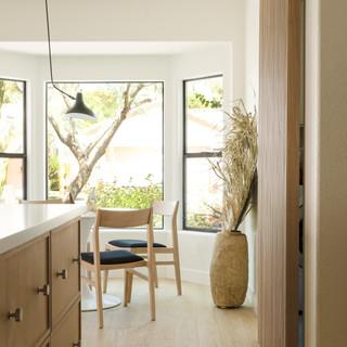 10-Simply Nordic-Scandinavian-Minimalistic-White oak-concrete-Terrazzo-Black Metal Stools-Wooden Slat Door-Undermount Lighting-White Dining Table-Shape Decor.jpg