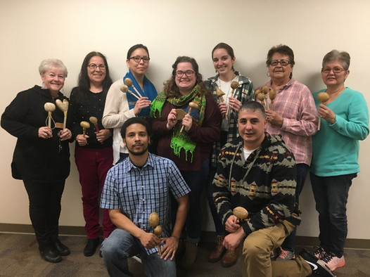Two VISTAs at the College of Menominee Nation both participate in a Rawhide Rattle Making workshop, let by a UW extension agent.