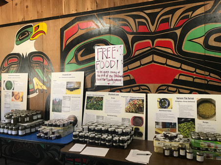 Hoonah Indian Association Food Fair table features local goods collected and prepped with help from the HIA VISTA.