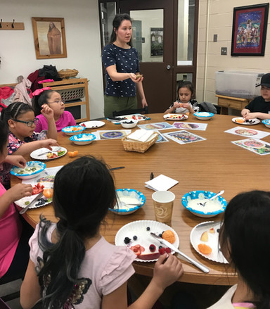 The VITSA at United Tribes Technical College, teaches 1st and 2nd graders about a variety of fruits as part of an after school program.