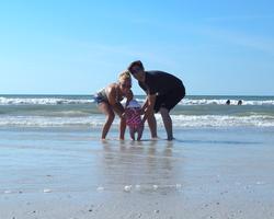 Adelyn's toes meeting the ocean
