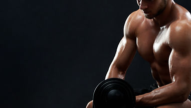 muscular-young-man-lifting-weights-black