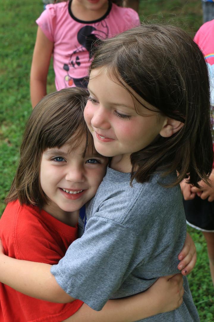 Picnic 2 girls hugging.jpg