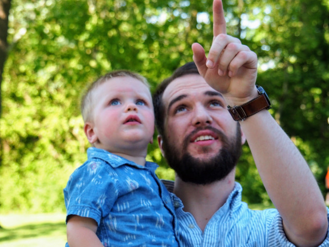 Picnic man and baby pointing.jpg