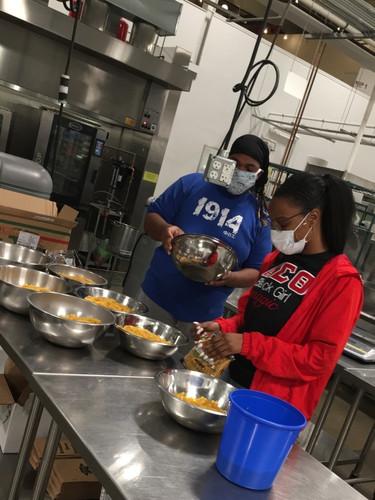 Volunteers prepare over 200 pasta meals