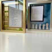 Examples of the framed original manuscripts mounted on top of original ethanol paintings