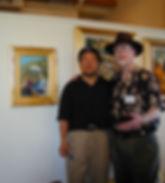 Jove Wang paints Roger's portrait.jpg
