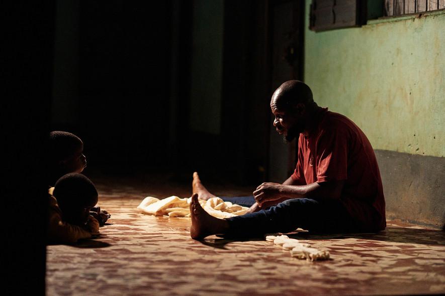 Young boys in Modiya watch Bengali work at night