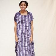 Mitchell Henderson, sunflower seed and logwood adire silk dress, worn by Sarah Nsikak
