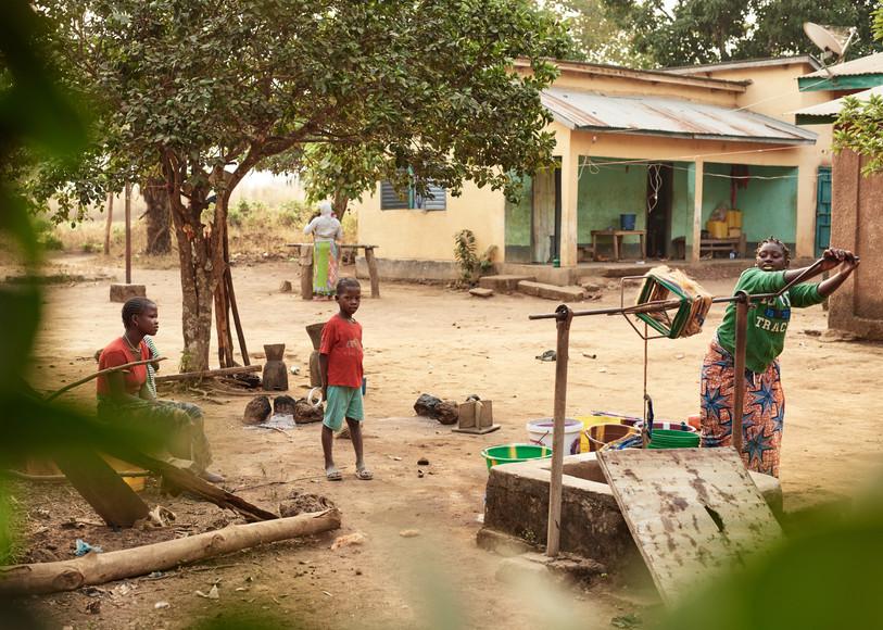 Girl collecting well water, Modiya