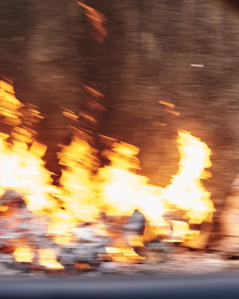 Trash fire roadside, Conakry