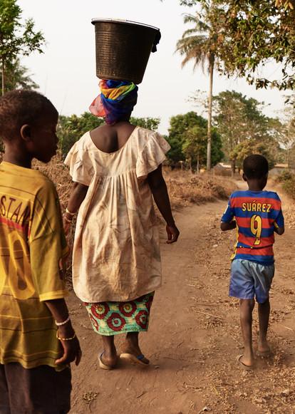 Mama Adama Souma collecting water