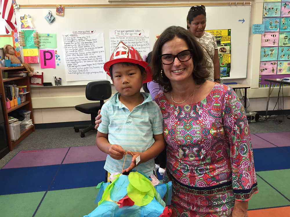 Kent with his kindergarten teacher extraordinaire, Señora Ziff. Kent is looking very studious in his polo shirt and fireman hat.