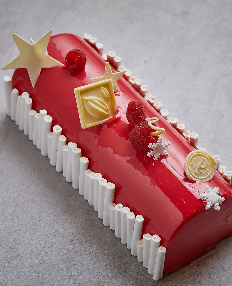 Bûche Choco Passion The Bûche Choco passion made with Raspberry, passion fruit & chocolate will make your Christmas, warm and sweet.