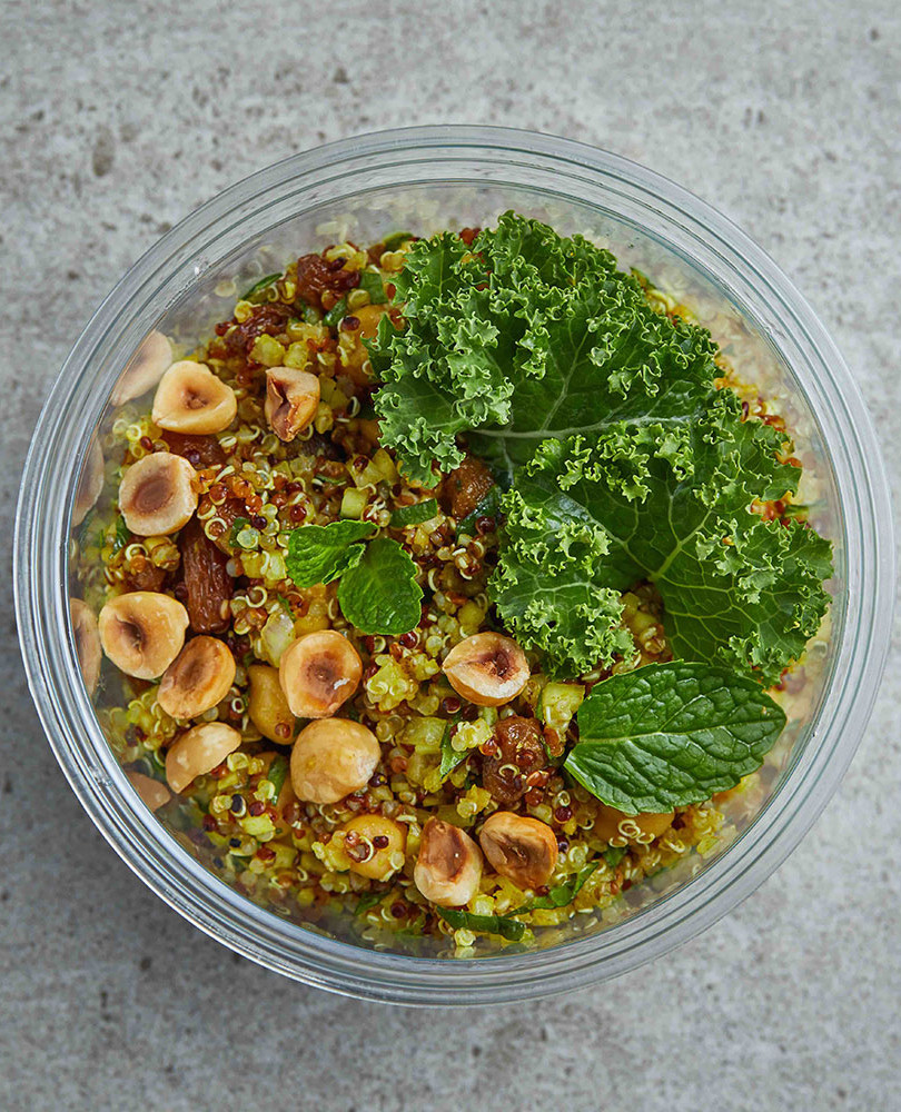 QUINOA SALAD The colours of the red and white quinoa mixed with some kale and chickpea are the main ingredients of this delicious salad.Chunks of pineapple, raisins, roasted hazelnuts, mint and curcuma. A dressing of cumin powder mixed with white balsamic vinegar give it an exotic twist to this vegetarian salad.