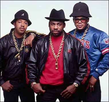 Hip Hop Group RUN DMC wearing oversized gold rope chains