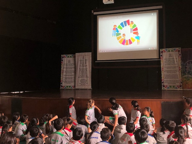 Children looking at the Sustainable Development Wheel