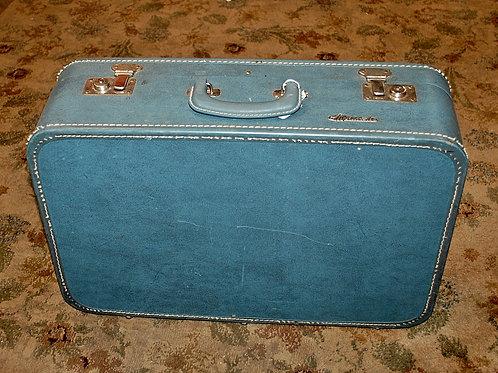 Sm.Lt.Blue Suitcase