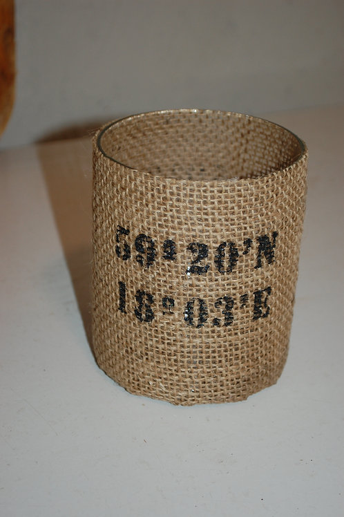 Glass container with burlap cover