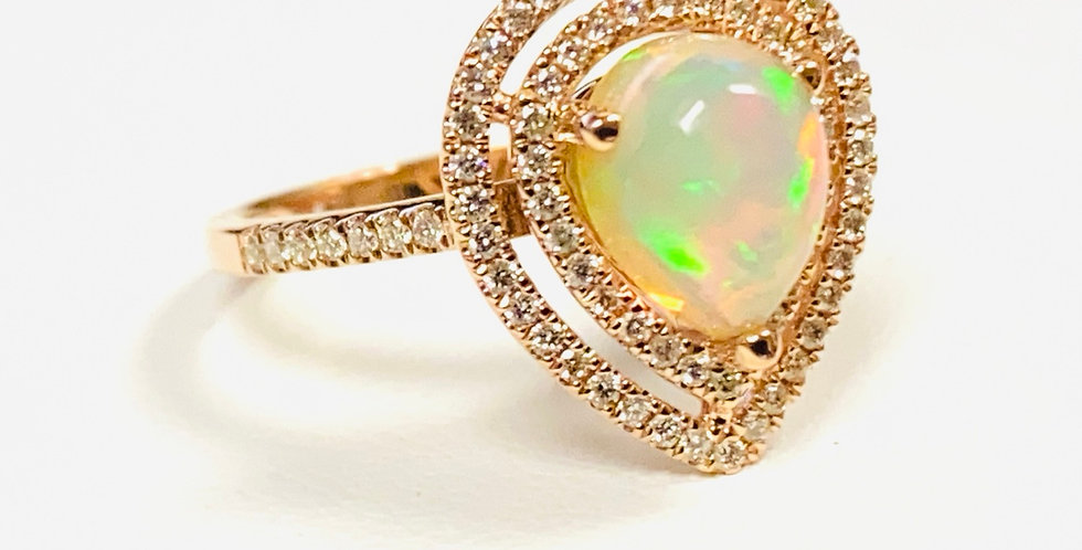 Pear Shape Opal 1.20ct & Double Diamond .40ctw Halo Ring in 14K Yellow Gold