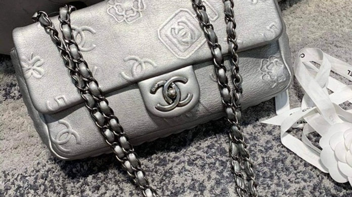 Chanel Silver Logo Flap Bag - PreLoved