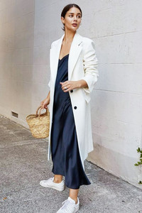 While coat with blue slip dress