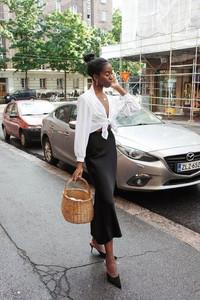 Tied white shirt, black skirt