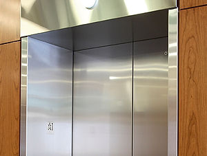 metal cladding and corner guards on elevator