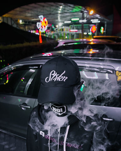 Smoker with Baseball Cap