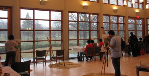 Artists painting views of winter landscape at Maple Grove.