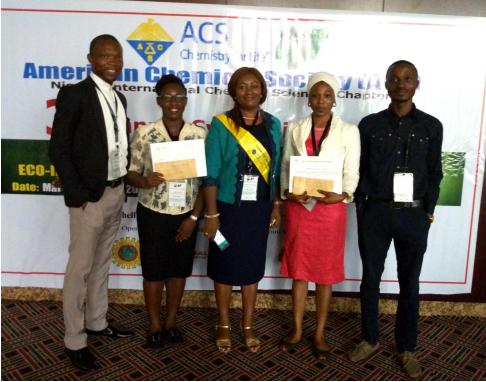 IYCN representatives Emmanuel C. Ohaekenyem (left) and Amusan Oluwatobi Omatola (right) with the two award winning students Inemesid (mid-left) and Hamzat (mid-right) and Dr. Nnemeka (center)