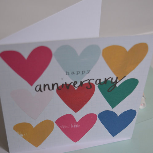 Happy anniversary greeting card, colourful modern hearts pattern