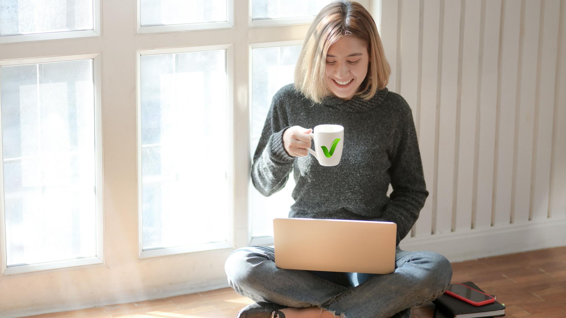 woman-in-gray-sweater-drinking-coffee-37